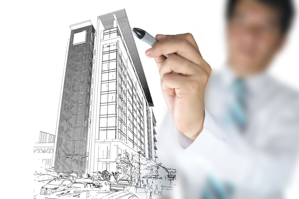 Man drawing tall building design